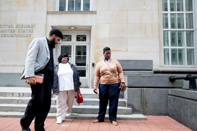 Tamaya Dennard, right, leaves the Potter Stewart U.S. Courthouse with family members after pleading not guilty to charges including bribery, attempted extortion in downtown Cincinnati on Monday, March 16, 2020.