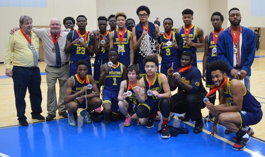 DePaul Cristo Rey won the Ohio Christian School Athletic Association state title on March 7 in Circleville. First row kneeling (left to right): Mouhamed Minani, Happy Ciza, Cameron Bird, Zion Rocquemore, Mohammed Diakite, Xavier Heath. Middle row standing left to right: Head Coach Randy Cornelius, Assistant Coach Jeff Birkofer, Martin Igaba, Bienveni Hamenyimana, Montez Johnson, Jurrien Nelson, Sereno Foster, Jeremiah Smith, Jullius Nelson, Assistant Coach Casey Troutman. Standing back row left to right: Team Manager Daniel Majekodunmi; Anderson Marde, Team Manager Samba Koita.