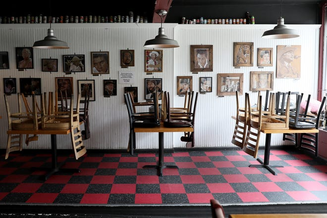 The dining room at Eli's Barbecue is closed in Cincinnati's East End neighborhood, March 16, 2020, following Ohio Gov. Mike DeWine's order to close all bars and restaurants.
