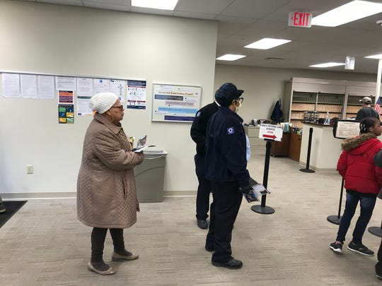 Esther Patton(left), 70, of Roselawn waits in line at the Hamilton County Board of Elections on Monday to cast her vote.