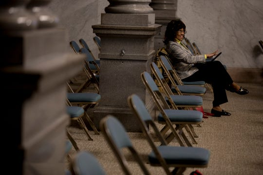Cincinnati Health Commissioner Melba Moore sits in a chair while preparing for the Cincinnati City Council's Law and Public Safety Committee meeting where she was presenting on Monday, March 16, 2020 at City Hall.