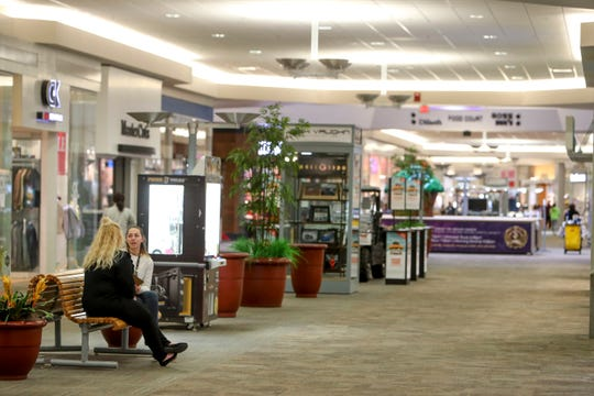A manager and potential employee sit down for an interview about a part time job to be filled in at a mostly empty Governor's Square Mall in Clarksville, Tenn., on Monday, March 16, 2020.