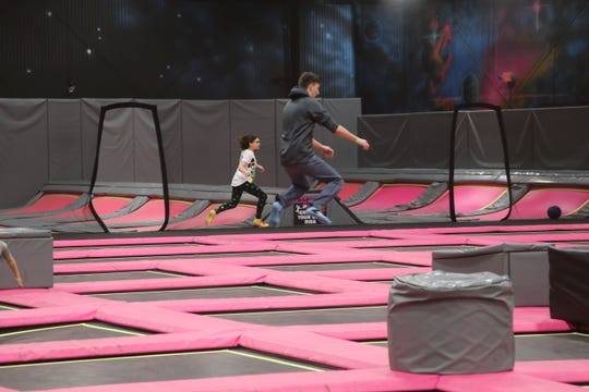 A couple jumpers get some air while bouncing at Defy Extreme Air Sports, formerly P3, in Clarksville on Monday, March 16, 2020, where business has slowed due to the spread of the coronavirus outbreak.
