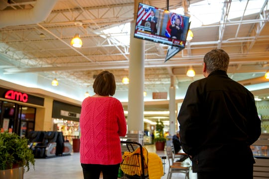Visitors watch televisions in the food court broadcasting Gov. Bill Lee's press conference to the state of Tennessee regarding Coronavirus's spread in the state at Governor's Square Mall in Clarksville, Tenn., on Monday, March 16, 2020.