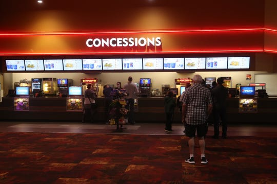 A handful of customers line up at the concession stand at the Regal Clarksville theater on Tiny Town Road on Monday, March 16, 2020. The theater manager said business has slowed and the theater has adjusted how they do business in light of the coronavirus outbreak.