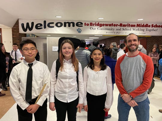 (From left) Luke Tan, Vanessa Fang and Sophia Fontaine with W+H band director Rick Fontaine.