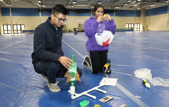 Rahul Singh (left) and Nami Jain of J.P. Stevens High School prepare their entry in Ping Pong Parachute.