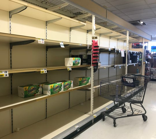 Shoppers are flocking to area stores, where they are finding some shelves are bare.