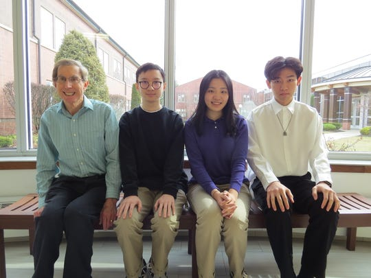 """W+H Upper School students Youran Wang, Class of '22; Silvia Xia, Class of '20; and Leo Song, Class of '21, pictured with Mark Donagy (Math Department Chair), posted impressive scores on the AMC 10A and AMC 12A exams and have qualified to take the American Invitational Mathematics Exam (AIME).    The cutoff scores were 87.0 for the AMC 12A and 103.5 for the AMC 10A. Song and Xia surpassed that mark in the AMC 12A and Wang reached the standard in the AMC 10A.   """"In the nine years that I have been teaching at Wardlaw+Hartridge, we have only had one other person to qualify to take the AIME,""""  Donaghy said."""