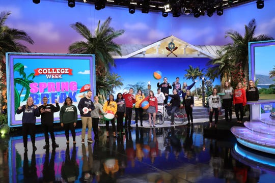 """The """"College Week Spring Break"""" contestants on the set of """"Wheel of Fortune."""""""