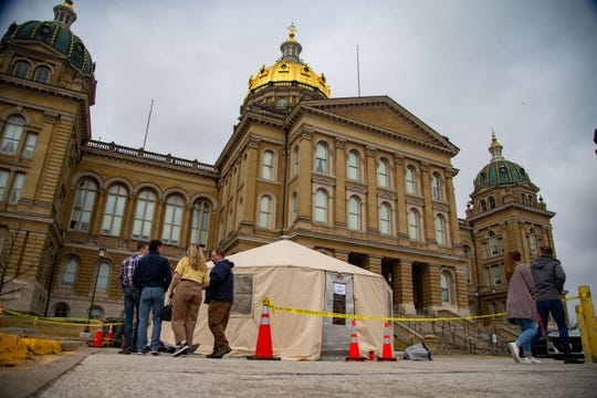 The Iowa Department of Public Health has set up tents to conduct health screenings on visitors to the Iowa State Capitol Monday, March 16, 2020.