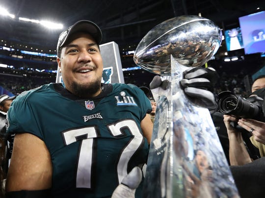Philadelphia Eagles tackle Halapoulivaati Vaitai holds the Vince Lombardi Trophy after a victory against the New England Patriots in Super Bowl LII in Minneapolis, Feb. 4, 2018.