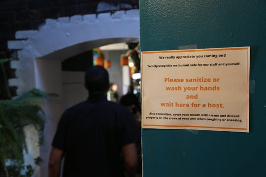 A handwashing sign at Mudgie's Deli in Corktown on Sunday, March 15, 2020, hours before the restaurant announced it would shut down indefinitely to discourage the spread of the novel coronavirus.