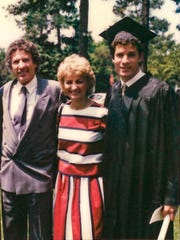Chris Ilitch, right, stands with his parents Mike and Marian on high school graduation day in June 1983 at Christ Church Cranbrook. The self-made entrepreneurs helped revive downtown Detroit during a time when others were leaving. (Photo courtesy of Chris Ilitch)