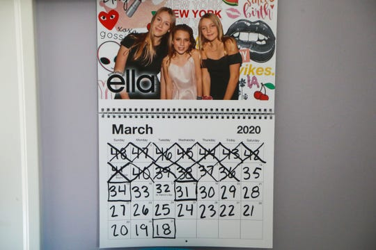 The calendar in Maya Belen's room shows the countdown for her Bat Mitzvah, a Jewish coming of age ceremony, at her home in Birmingham, Mich. on Saturday, March 14, 2020. Belen's Bat Mitzvah has been postponed due to the Coronavirus until June.