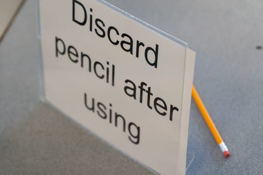 Pencils to be used for students checking out laptops for at-home work lay on a table at Roosevelt Elementary School in Keego Harbor on Monday.