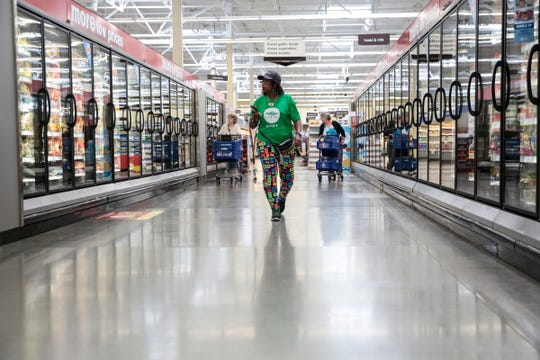 Shipt shopper Gina Moorman of Detroit, looks for waffle fries in the frozen food section at Meijer, on June 22, 2017 in Detroit.