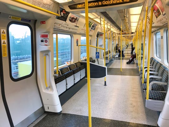 A sparsely-filled carriage on an Underground train in west London as many office staff in the capital opted to work from home as a precaution against coronavirus Monday.