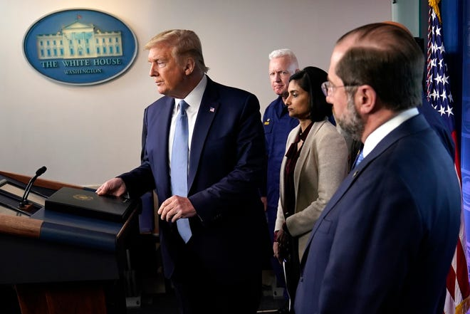 President Donald Trump arrives to speak at a press briefing with the coronavirus task force, in the Brady press briefing room at the White House, Monday, March 16, 2020, in Washington.