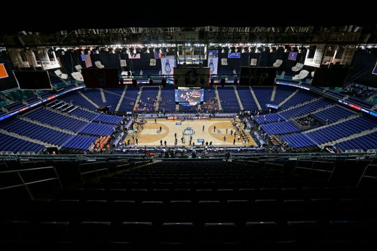 Greensboro Coliseum is mostly empty after the NCAA basketball games were canceled at the Atlantic Coast Conference tournament in Greensboro, N.C., Thursday.