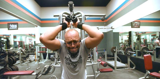 Kenneth Martin, of Madison Heights, works out his triceps Saturday at The Royal Oak Gym.