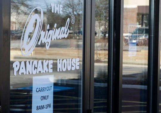 "A sign for ""carryout only"" at the Original Pancake House, Monday, March 16, 2020, in Woodmere Village, Ohio. All bars and restaurants in Ohio will be closed until further notice, said Gov. Mike DeWine. Michigan Gov. Gretchen Whitmer's similar order goes into effect at 3 p.m."