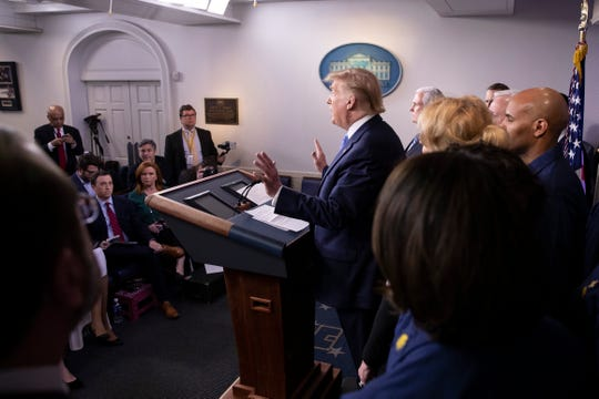 President Donald Trump speaks during a briefing about the coronavirus in the James Brady Press Briefing Room of the White House, Sunday in Washington.