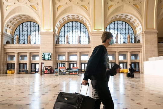 Washington Union Station, a major transportation hub in the nation's capital, is nearly empty during morning rush hour as many government and private sector workers stay home during the coronavirus outbreak, in Washington, Monday.