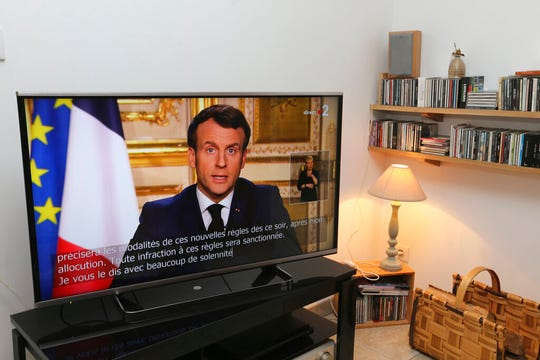 "French President Emmanuel Macron speaks during a television address, Monday, March 16, 2020 in Ciboure, southwestern France. Macron said that restrictions on how far from their homes people can go and for what purpose will be imposed, saying, ""movements will be very strongly reduced"" for 15 days starting at midday Tuesday."