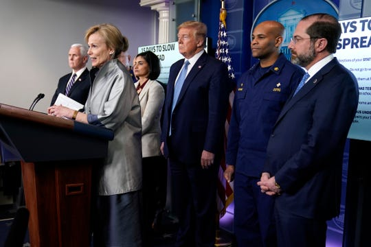 President Donald Trump listens as Dr. Deborah Birx, White House coronavirus response coordinator, speaks during a press briefing with the coronavirus task force, in the Brady press briefing room at the White House, Monday, in Washington. Also listening are Vice President Mike Pence, Administrator of the Centers for Medicare and Medicaid Services Seema Verma, U.S. Surgeon General Jerome Adams and Health and Human Services Secretary Alex Azar.