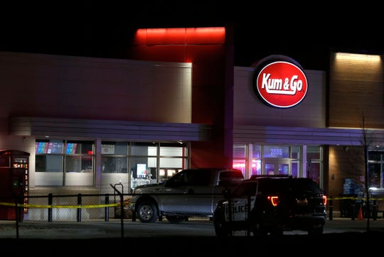 Police respond to the scene of a shooting at a gas station in Springfield, Mo, on Sunday.  Police Chief Paul Williams said Monday morning, a Springfield police officer, three citizens and the gunman were killed.