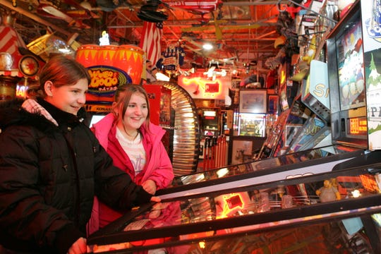 In this file photo, Sarah McMorran, 11, and her older sister Katie, 14,  play at  Marvin's Marvelous Mechanical Museum in Farmington Hills.