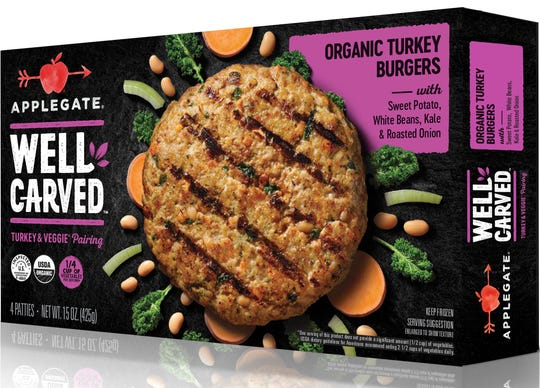 This photo provided by Applegate Farms shows Applegate Well Carved Organic Turkey Burgers, a line of meat-and-veggie burgers which the company is introducing at grocery stores next month.  (Applegate Farms via AP)