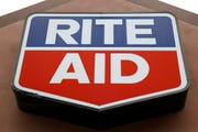 This June 24, 2019, file photo shows a sign for a Rite Aid location in Philadelphia. Rite Aid Corp. will unveil plans for a turnaround at an online analyst day Monday, after two thwarted merger attempts left the drugstore chain wounded and much smaller than its rivals.