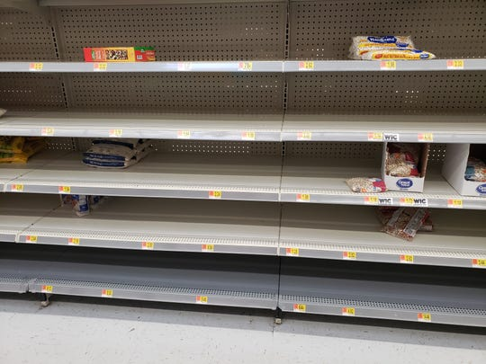 Non-perishable dry goods like rice, beans and instant noodles are nearly out at Walmart, 377 N. Rolling Meadows Drive, Fond du Lac.