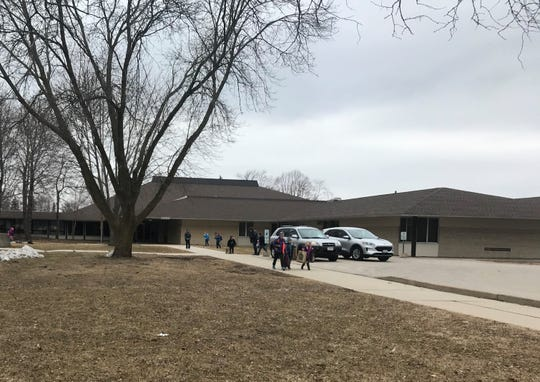 Students leave Roberts Elementary School, Monday, March 16, 2020, after Gov. Tony Evers ordered all public and private schools closed due to the coronavirus.
