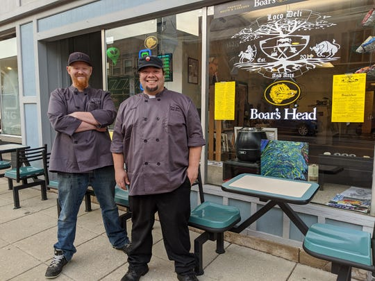 Loco Deli and Arts co-owners Lucas Palomo, right, and Zach Beckman, left, say they are offering delivery and take out after governor Mike DeWine announced bars and restaurants will close to dine-in customers.