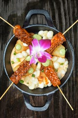 The pulpo anticuchero from Ceviches by Divino features skewers of octopus, seasoned potatoes and rocoto pepper.