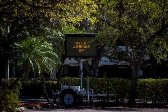 A lighted billboard gives instructions to community members seeking tests for the Coronavirus (COVID-19), Monday, March 16, 2020, at NCH Baker Hospital in Naples. Those waiting to seek testing were advised to keep their windows rolled up.