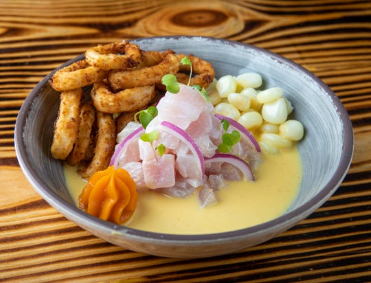 Ceviches by Divino's ceviche de mercado features fresh corvina and fried squid.