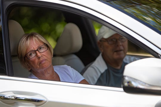 Naples residents Sharon and Tom Chmura wait to be tested for Coronavirus (COVID-19), Monday, March 16, 2020, at NCH Baker Hospital in Naples. The couple were first in line to receive the test.