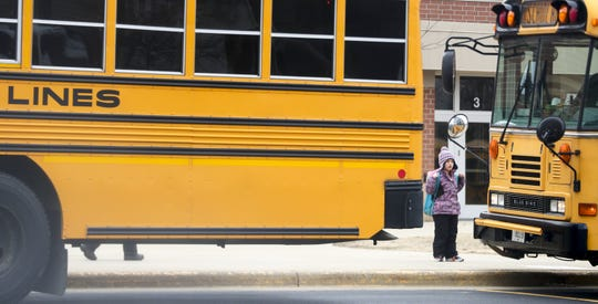Bay Harbor Elementary School students leave school on Monday, the last day of school until at least April 6 under a statewide order to shut down schools to slow the spread of the new coronavirus.