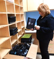 North Pointe Elementary School Principal Jill Gilreath looks over Chromebooks for students on Monday, March 16, 2020.