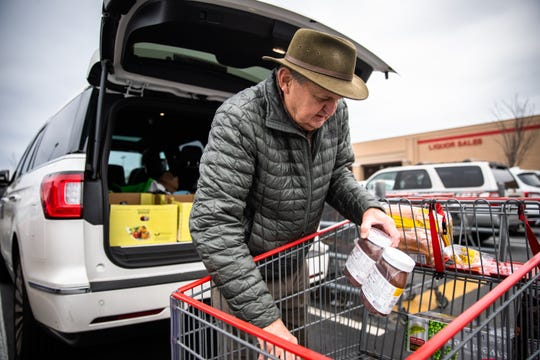 Mike Stevens, of Greenville, SC, loads up his car with groceries from Costco in preparation for effects of the coronavirus pandemic Monday, March 16, 2020.