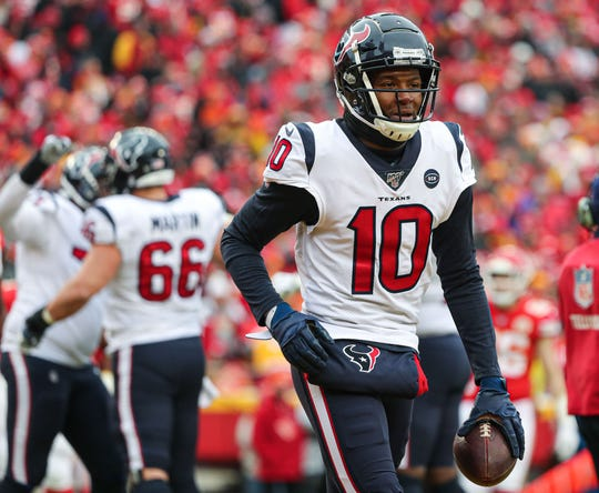 Jan 12, 2020; Kansas City, Missouri, USA; Houston Texans wide receiver DeAndre Hopkins (10) reacts after a touchdown against the Kansas City Chiefs during the first half in a AFC Divisional Round playoff football game at Arrowhead Stadium. Mandatory Credit: Jay Biggerstaff-USA TODAY Sports