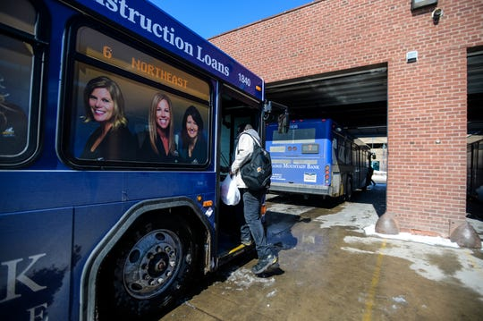 Passengers board buses at the Great Falls Transit District Transfer Center in downtown Great Falls. Many people with mental illnesses lost their main source of transportation when bus routes shut down in mid-March.