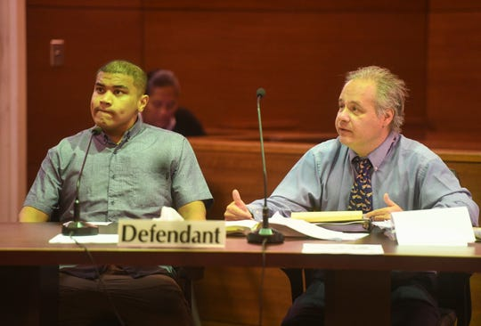 Brandon Acosta, left, with his defense attorney William Pole during trial at the Superior Court of Guam on March 16, 2020.