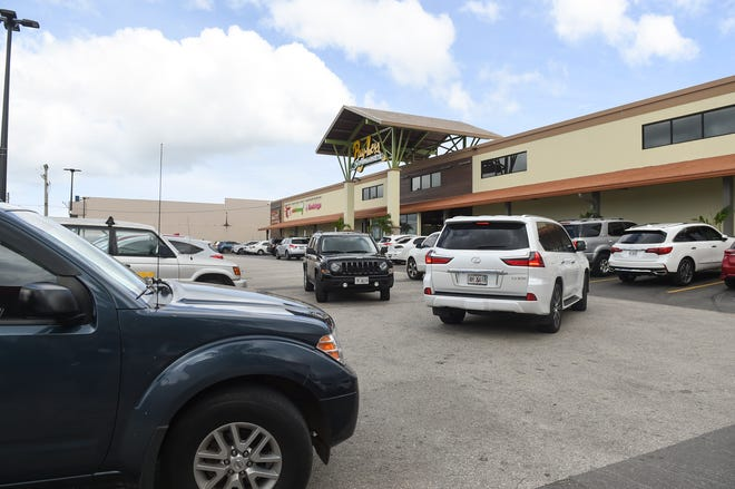 Customers search for parking at a crowded Maite Pay-Less following Gov. Lou Leon Guerrero's announcement of positive coronavirus cases on Guam, March 16, 2020.