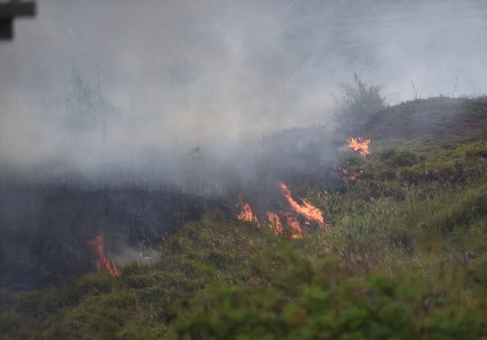 A large grass fire in a valley off Route 17 on Cross Island Road is shown in this March 16 file photo. A fire weather watch is in effect for Guam on Saturday.