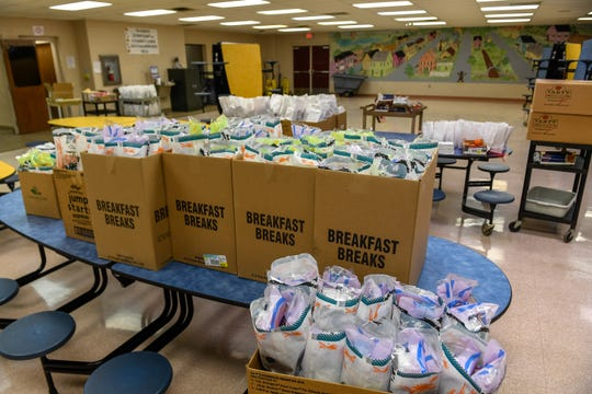 With school suspended because of the coronavirus pandemic, breakfast and lunch bags ready to go out as Henderson County Schools employees began to distribute free breakfast and lunch meals to anyone 18 years old or younger Monday morning, March 16, 2020.